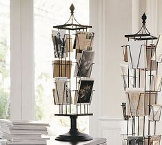 Every time my man travels for business he brings me back a love note on a postcard from where he was. This is how I store them :) Tabletop Photo Carousel #potterybarn