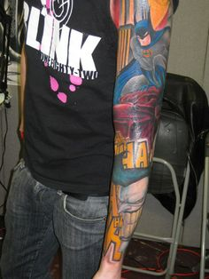 Batman Tattoo Sleeve...I partly repinned this because the tat is sweet but more so because of the Blink182 shirt