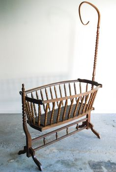 Antique Crib / Swinging Bassinet + Gorgeous antique bentwood baby cradle circa 1900. + Skillfully handcrafted from solid walnut. + Beautifully shaped