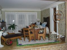 1:12 scale dollhouse replica of a real Italianate style Victorian home in Whitewater, Wisconsin - The dollhouse features 10 rooms and measures 6 x 12 ft., $26,000 on E-Bay.