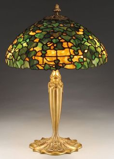 A stunning Duffner & Kimberly table lamp with allover ivy pattern in a range of striated greens in just as many textures on a sparkling apricot background Tiffany Lamp Shade, Tiffany Chandelier, Tiffany Lamps, Stained Glass Table Lamps, Stained Glass Art, Stained Glass Windows, Victorian Lamps, Lights Fantastic, Led Light Fixtures