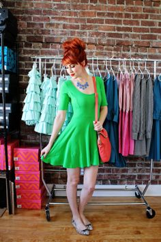 Eye popping green dress on a red haired beauty.