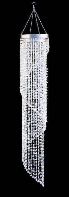 This beautiful 4 foot long swirl beaded chandelier looks like its made of real crystals but its acrylic... The 10mm beads swirl around like a spiral staircase. Included with the chandelier is a separa
