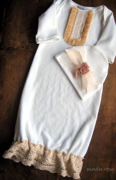 Beautiful vintage inspired gown and hat for baby girl.    Super soft gown is made of white cotton knit. It features a lap shoulder neckline accented