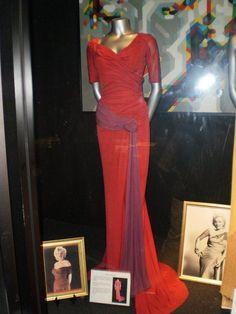 Marilyn's crimson Oleg Cassini gown...the designer of my wedding gown! LOVE!
