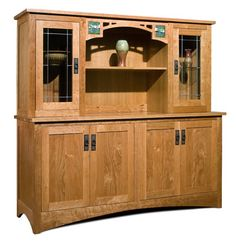 The Skara Brae: cherry cabinet with leaded glass windows, lighted interior, handmade Motawi tiles, and cutout features on the arched skirt. By Center of the World Wood Shop.
