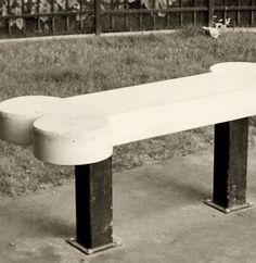 M.        Dog Bone Concrete Bench