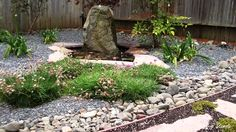 A small Japanese-style garden adds excitement to a woodsy backyard. Japanese gardens combine the basic elements of water, plants, and rocks with clean, simpl...