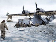 US Navy personnel free a PBY Catalina from Kodiak Bay, Alaska, during the Second World War.