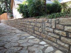 Chopped stone retaining wall