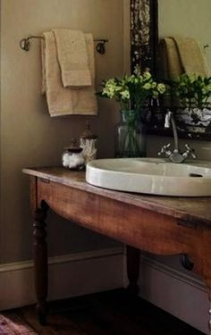 I like the idea of a heavy table as a countertop for the sink