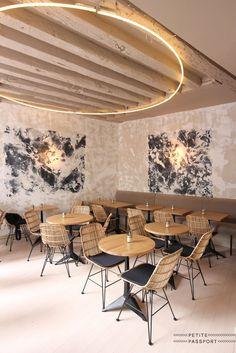 Restaurant Lighting Ideas | Unique lighting fixture in a mid century modern design. #restaurantinterior #restaurantinteriordesignideas #restaurantlightingideas #restaurantdiningchairs