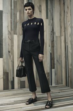 Alexander Wang Resort 2016 - Look 14 - I feel like this could be a nod to Interstellar - the stark, pristine, utilitarian black ribbed sweater with orb-shaped tiny cutouts.