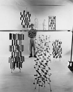 Harry Bertoia (1915 – 1978) poses with model of his screen/sculptures, 1950's. Photo: Knoll
