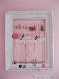 a picture frame and some pretty scrap trims are all it takes to keep your little jewelry junkie organized!