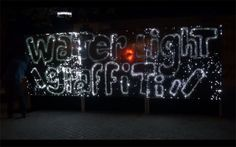 A French artist has built a giant water-sensitive light-board for your artistic pleasure. Participants use a water gun, a brush or a spray bottle to create patterns of moisture that light up the board.