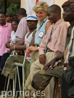 January 14, 1997: Diana, Princess of Wales with landmine victims at the the Neves Bendinha Orthopedic Workshop on the outskirts of Luanda, Angola.