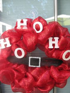 HO HO HO Santa Wreath Large - red mesh deco with white glitter letters, black mesh belt with silver glitter buckle. $75.00, via Etsy.