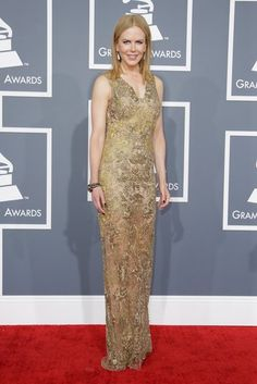 DO :) Nicole Kidman lit up the red carpet in a gold embroidered Vera Wang gown. #grammys