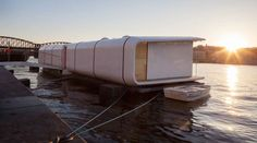 Port X designed by architects Jerry Koza and Adam Jirkal, along with engineer Tomáš Kalhaus from Atelier SAD is a modular home that can pop up on land or water. Floating Architecture, Sustainable Architecture, Wooden Boat Plans, Wooden Boats, Boat Building, Green Building, Utility Boat, X Project, Romanesque Architecture