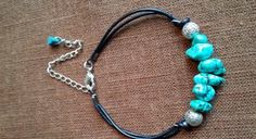Turquoises , leather and silver metal