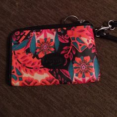 Gorgeous Fossil Wristlet NWOT Fossil Wristlet with gorgeous flower design.  Flowers are red, orange and pink with green leaves on black background. Synthetic materials. Very Pretty! NWOT Fossil Bags Clutches & Wristlets