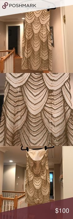 Gold beaded show stopping dress ! Gold beaded strapless dress. Amazing condition, lightly worn once and what a showstopper. Pair it with the gold badgley mischka heels in my closet ;) Jovani Dresses Midi