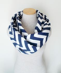 I have a thing for scarvs...Navy Blue and White Chevron Infinity Skinny Scarf. $20.00, via Etsy.