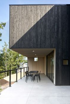 Two-toned wood facade wraps Washington home by Open Studio Collective Wood Facade, Wood Siding, Basement Floor Plans, Architectural Materials, Charred Wood, Wood Architecture, Ground Floor Plan, Minimal Decor, River House