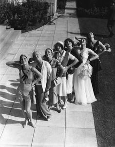 Women posing during a fashion show in Beverly Hills, California, ca. 1930.