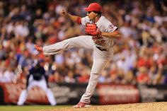 Relief pitcher Carlos Martinez delivers against the Colorado Rockies... Cards won the game 11-4.  9-17-13