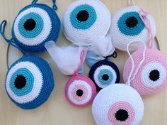 handknitted evil eyes