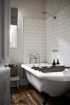 Weu0027re In Love With This Simple Bathroom Design. White Subway Tiles, Wood  Flooring U0026 A Large Claw Foot Tub Are Absolutely Gorgeous.