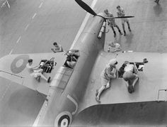Arming a Hawker Sea Hurricane fighter on board HMS Indomitable.