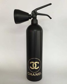 Matte Black and Gold Chanel by Niclas Castello.  #NiclasCastello  #Chanel #extinguisher #DLTD_SCENES #Magazine #inspiration #photography #art #konst