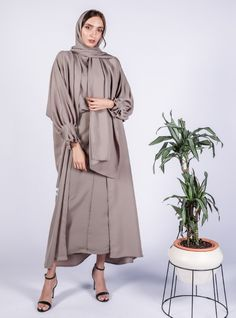 Olive Silky soft olive abaya, High end edgy contemporary wear. Modern Hijab Fashion, Modesty Fashion, Hijab Fashion Inspiration, Abaya Fashion, Muslim Fashion, Fashion Dresses, Iranian Women Fashion, Abaya Designs, Engagement Dresses