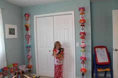 What do you do when your daughters' Lalaloopsy collection takes over her room...You display them hanging on the walls in their playroom, of course! #Lalaloopsy #Trim #Lalalovely #Dolls #GirlsRoom #KidsRoom #Toys