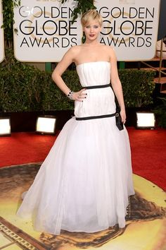 Golden Globes 2014 Dresses – Red Carpet Dresses and Outfits (Vogue.com UK) Jennifer Lawrence – who took home the Best Supporting Actress in a Musical or Comedy award for American Hustle - wore a gown from the Dior Couture autumn/winter 2013 collection and carried a Roger Vivier clutch.