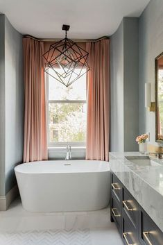 Marlborough Street Residence - Elms Interior Design - Master Bathroom - Beautiful freestanding bathtub with Kelly Wearstler Cubist Chandelier #masterbathroombathtub