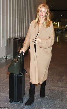 Casual: Rosie Huntington-Whiteley arrived at Japan airport on Friday ...