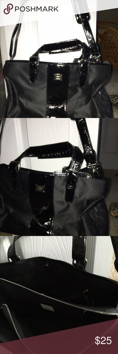 Liz Claiborne Purse Black purse, with hand held or cross body/ shoulder strap, multi compartments like a briefcase almost. Never used. Liz Claiborne Bags Totes