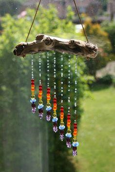 #beads We're lovin' this chakra inspired sun catcher!  Learn which gemstones balance the chakras here: http://blog.happymangobeads.com/…/balance-chakras-gemstone…/