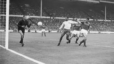 Portugal's Eusebio forces his way between two Russian players, only to see his shot saved by Russian goalkeeper Lev Yashin, during the World...
