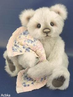 Bear with Its Eyes, Nose, and Feet Moving and Holding a Blankie