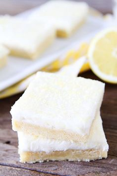 Lemon Sugar Cookie Bars...soft and chewy lemon sugar cookie bars topped with lemon cream cheese frosting! Perfect bars for parties and entertaining!