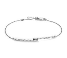 Captivate a crowd with this diamond bar bracelet set against 14k white gold.