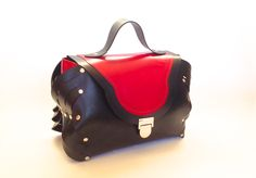 Compur Satchel in rubber & leather.