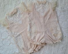 Part of our Cherished Heirloom Collection. The Avalon Romper is of heirloom quality and can be cherished for years to come. Features a beautiful soft cotton with tiny threads creating a darling print. Real vintage lace pieces accent the bottom half of the romper and another beautiful lace piece accents the front top. A tiny button fastens the back top of the romper and snaps fasten the bottom for easy dressing.PLEASE NOTE: Option 1 and 2 feature different vintage lace.