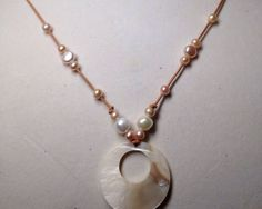 A personal favorite from my Etsy shop https://www.etsy.com/listing/228587741/shell-pendant-freshwater-pearl-and