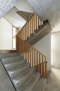 Concrete stairs with wooden balustrade